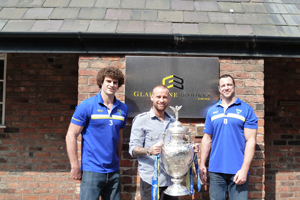 Gladstone Brookes Sales Manager Gary Watmough with Warrington Wolves Adrian Morley and Matt King with the Challenge Cup outside the Gladstone Brookes office