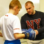 Anthony Rimmer helps one of the pupils get gloved up