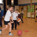 Liam leads the basketball dribbling practice