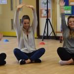 Jenni and Emma doing stretching exercises