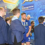 Craig with a group of the students looking at the Heritage Wall in the South Stand concourse